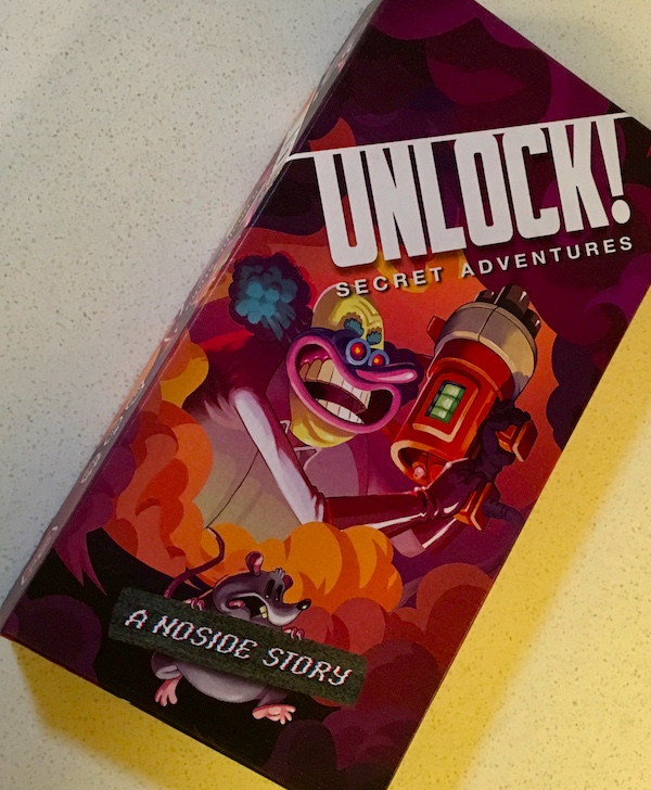 Unlock - A Noside Story box features the evil clown holding a ray gun.