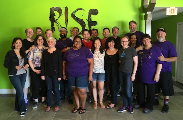 Lisa's bus gathered for a group photo at RISE.