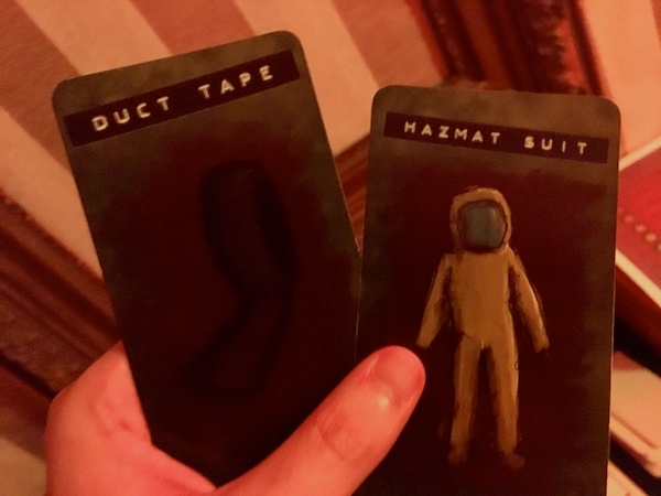 In-game: cards representing duct tape and a hazmat suit.