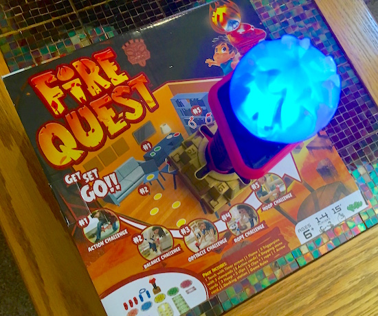 In-game: The torch glowing blue on its cradle and the Fire Quest box.