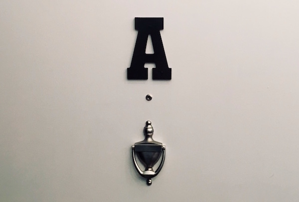 "In-game: the door for Apartment ""A"" with a peephole and a knocker."
