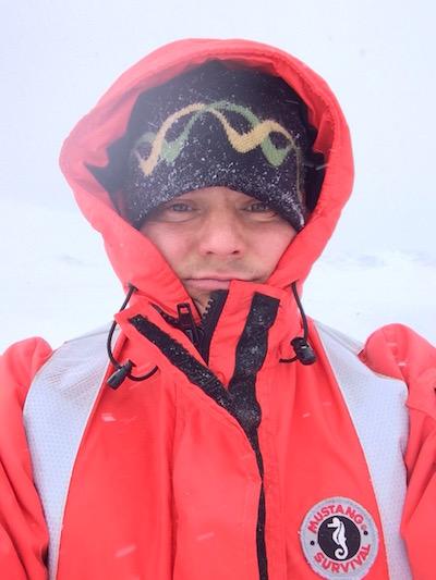 Steve Ewing in a bright orange jacket in Antarctica