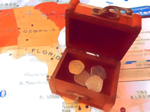 A small treasure chest with coins inside.