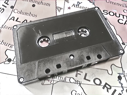 Black & white image of a cassette tape on a map of the US.