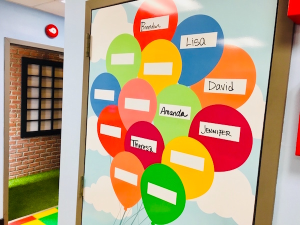 In-game: A wall poster with balloons where each player (student) wrote their name.