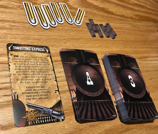 In-game: An intro card explaiing the story, two decks of cards, 6 card stock bullets, and 5 bits of gray card stock.