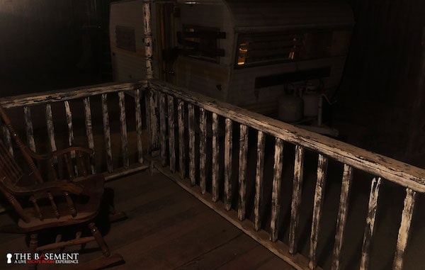 In-game: an aged porch with a rocking chair.