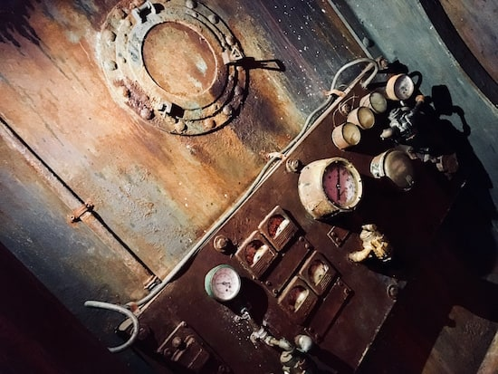 In-game: a rusty and weathered sit of dials and gauges.