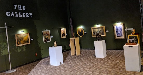 The Museum of Intrigue's art gallery with paintings and sculptures on display.