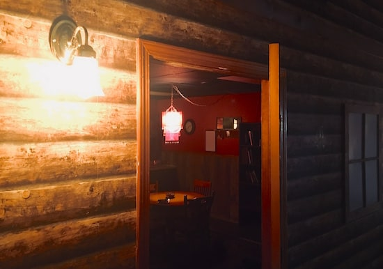 In-game: A view from the entry door into the cabin.