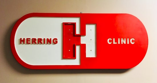 "The ""Herring Clinic"" logo, it's a red pill with an ""H"" on it."