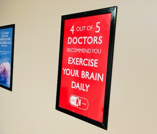 "In-game: A poster that reads, ""4 out of 5 doctors recommend you exercise your brain daily."""