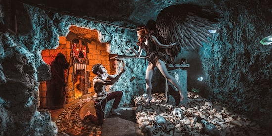 Claustrophobia game promo: a black winged angel in a tomb