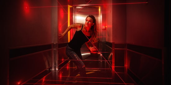 Claustrophobia game promo: a woman in a laser maze