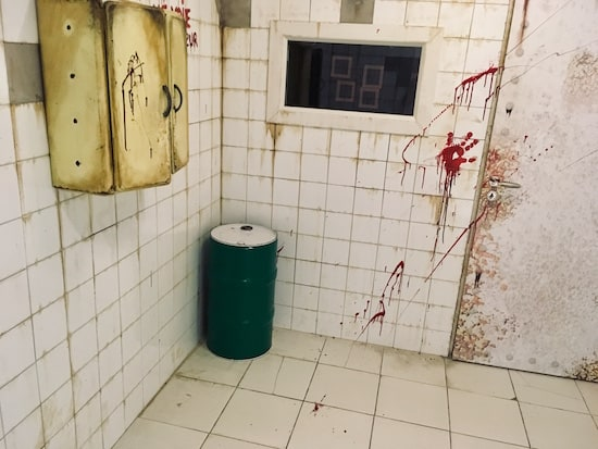 In-game: A dingy, bloodied white-walled asylum.