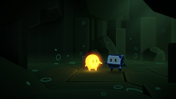 Glo and Bulder holding hands in a cave.