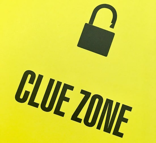 "In-book, page reads, ""Clue Zone"" with an unlocked padlock."