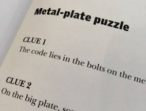 In-book, page,shows portions of the first puzzle's hints.