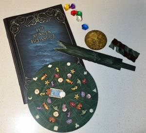 The sunken treasure journal, decoder wheel, and an assortment of small components.