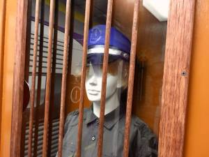 In-game: a mannequin wearing a train conductor uniform in a ticketing booth.