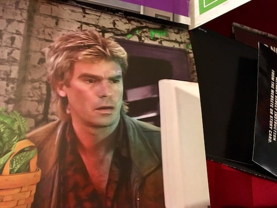 In-game: Close-up image of MacGyver looking at a computer.