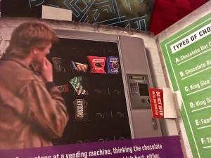 In-game: Image of MacGyver looking at a a candy vending machine.