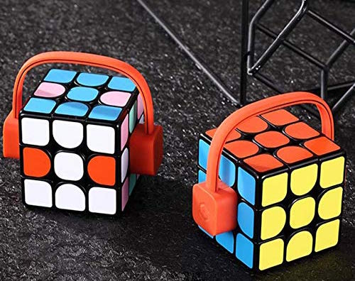 2 Rubik's cubs with funny looking headset power chargers on them.