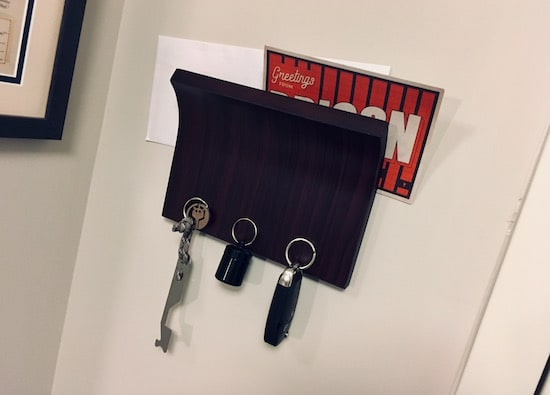 Umbra Magnetic Key Holder with keys and mail in it.