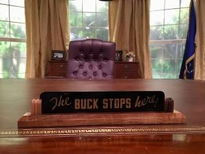"In-game: President Truman's ""The BUCK STOPS here!"" sign on the President's desk."