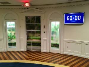 In-game: A 60 minute timer screen beside the windows and doors of the Oval Office.