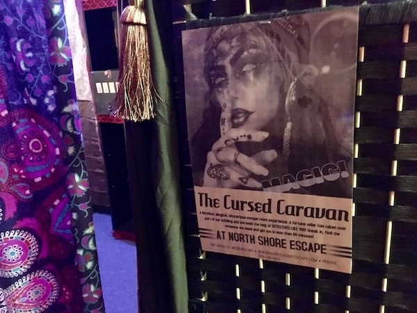 "In-game: The poster for ""The Cursed Caravan at North Shore Escape."""