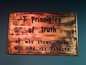 "In-game: sign reads, ""7 principles of truth: he who knows these will find the Panacea."""