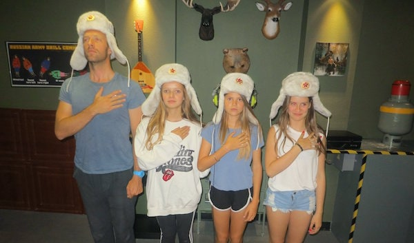 Coldplay singer Chris Martin with his daughters in 60 Out's Red Alert escape room.