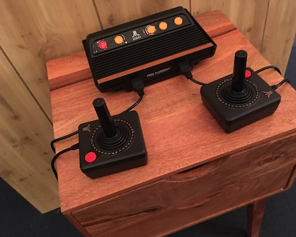 In-game: Closeup of an Atari and it's joysticks.