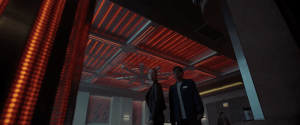 Two characters standing in a room that has turned into an oven.