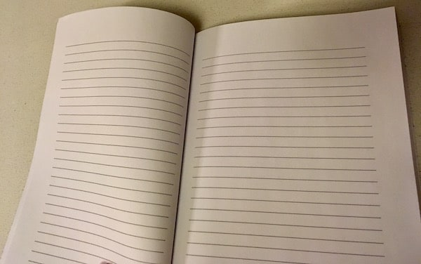 A blank notebook with horizontal rules.