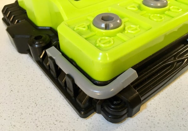 Closeup of an allen key attached to the corner of the device.