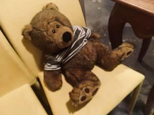 In-game: A big stuffed teddy bear sitting on a chair.