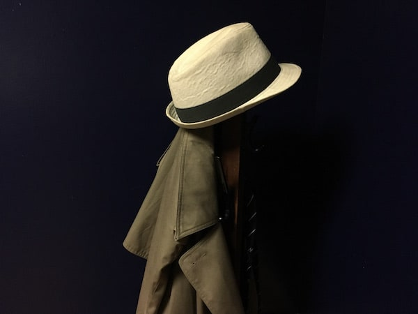 In-game: A trench coat and fedora on a coatrack.