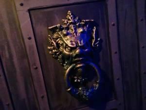 In-game: an ominous metal door knocker.