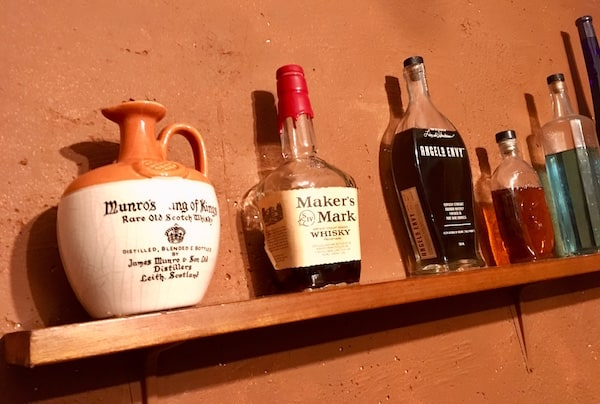 In-game: Liquor bottles on a shelf.