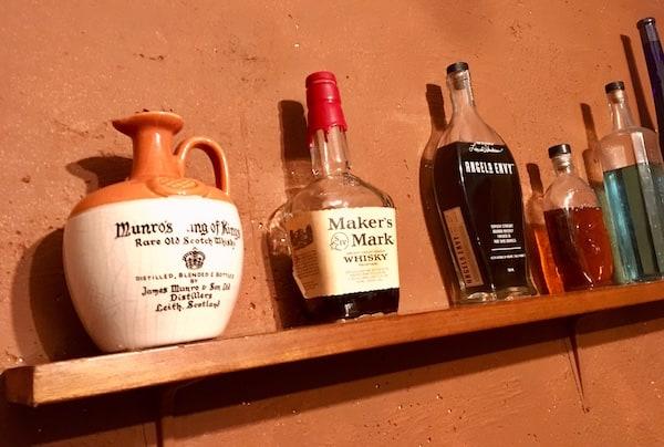 In-game: Liquor bottles on a shelf.