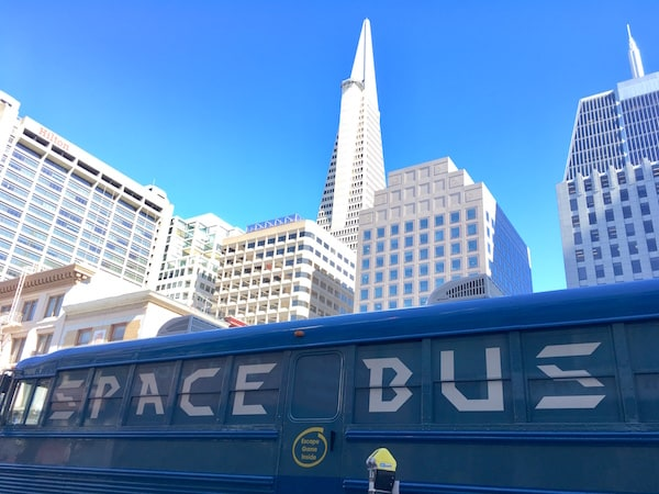 In-game: The Space Bus school bus with the Transamerica Pyramid in the background