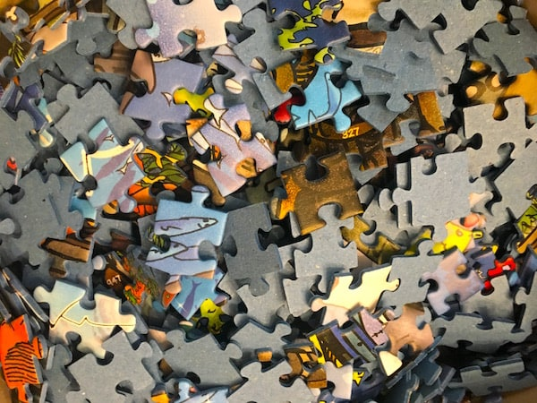 An assortment of unconnected jigsaw puzzle pieces.
