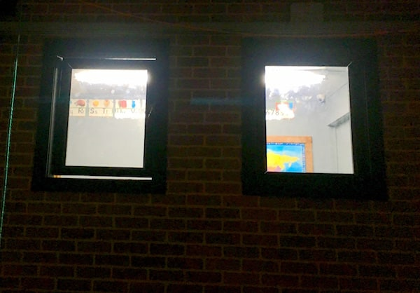 In-game: A view into a classroom from the outside of the school.
