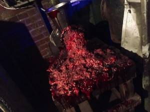 In-game: A meat-grinder oozing large amounts of ground, bloody flesh.