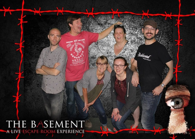 A team photo from THE BASEMENT. One player looks like a disembodied head due to green screen funniness.