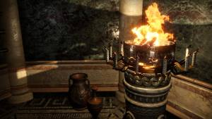In-game: a burning cauldron in a temple.