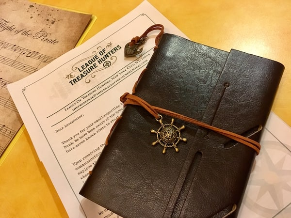 A leather bound journal and a letter.
