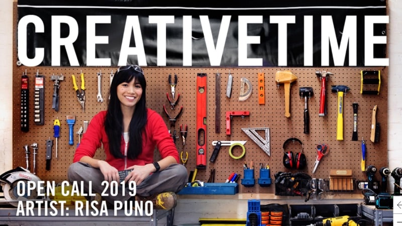 Risa Puno sitting on her workbench.